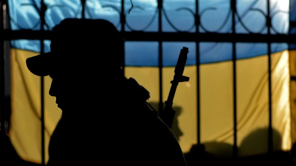 The silhouette of a Ukrainian soldier is seen against a Ukrainian flag as Ukrainian soldiers wait inside the Sevastopol tactical military brigade base in Sevastopol on March 3, 2014. Russian forces have given Ukrainian soldiers an ultimatum to surrender their positions in Crimea or face an assault, a Ukrainian defence ministry spokesman said. 'The ultimatum is to recognise the new Crimean authorities, lay down our weapons and leave, or be ready for an assault,' said Vladyslav Seleznyov, the regional ministry spokesman for the Crimea. AFP PHOTO / FILIPPO MONTEFORTE (Photo credit should read FILIPPO MONTEFORTE/AFP/Getty Images)