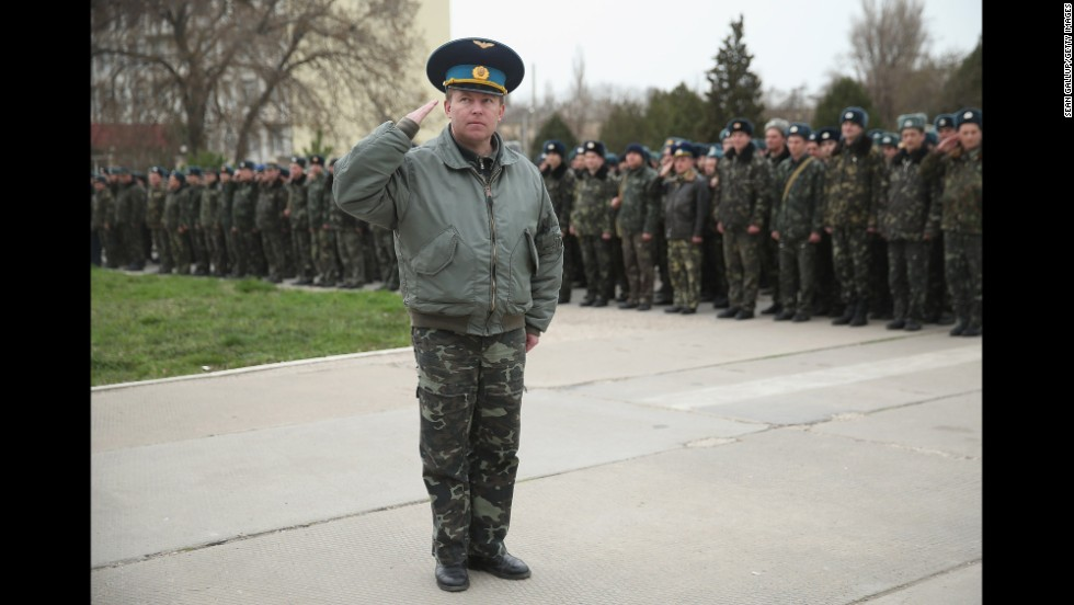 Yuli Mamchun, the commander of the Ukrainian military garrison at the Belbek air base near Sevastopol, salutes on March 4.
