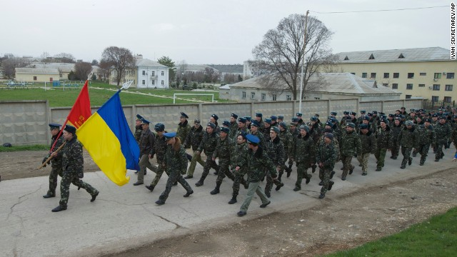 Unarmed Ukrainian military members march at the Belbek air base on March 4.