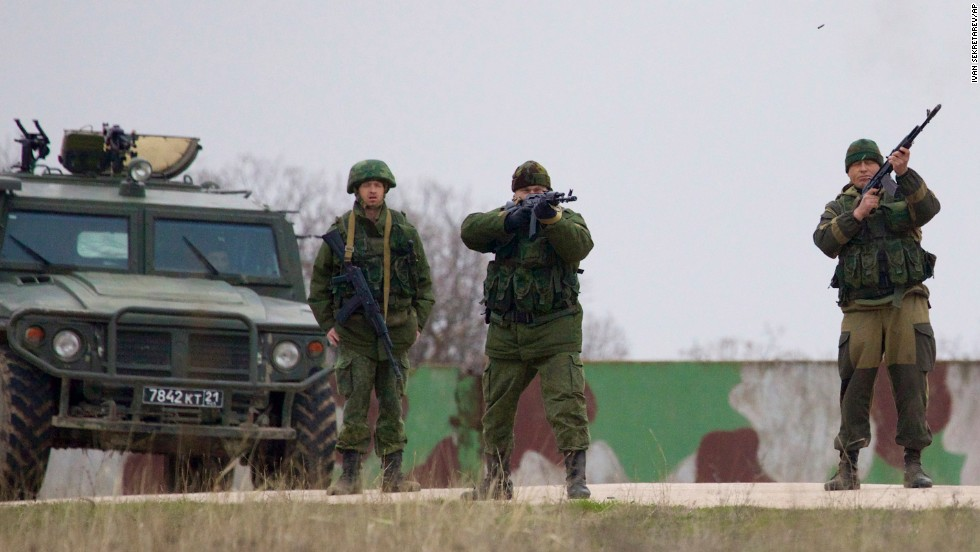 Russian soldiers fire warning shots to keep back Ukrainian military members at the Belbek air base on March 4.