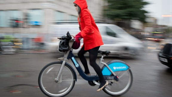 A cyclist rides on a Boris Bike in central London on November 20, 2013.