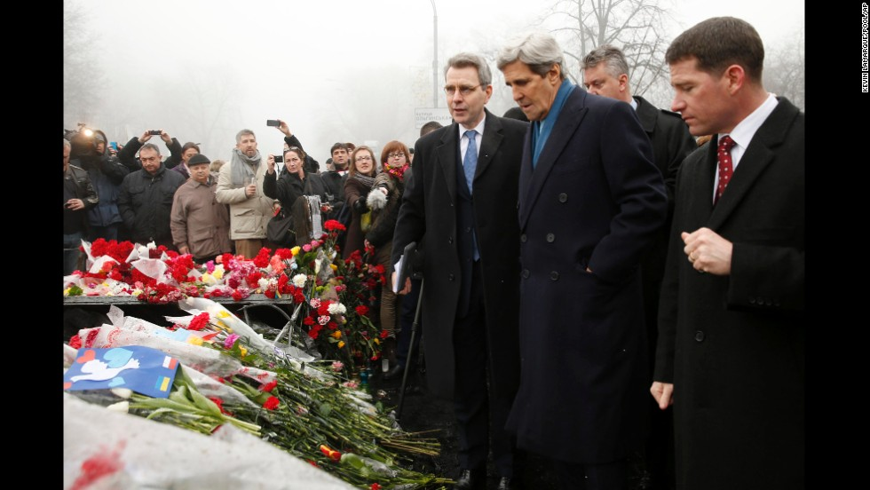 U.S. Secretary of State John Kerry, wearing a blue scarf, visits a shrine March 4 for the people who were killed in February during anti-government protests in Kiev.