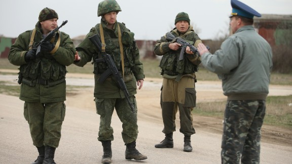 A commander at the Ukrainian military garrison at the Belbek airbase speaks to troops under Russian command occupying the Belbek airbase in Crimea on March 4, 2014 in Lubimovka, Ukraine.