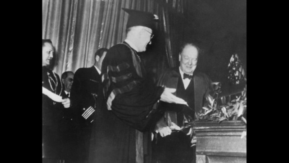 """President Harry S. Truman introduces Winston Churchill at Westminster College in Fulton, Missouri, on March 5, 1946. In his speech, the former British prime minister declared, """"From Stettin in the Baltic to Trieste in the Adriatic, an Iron Curtain has descended across the Continent."""""""