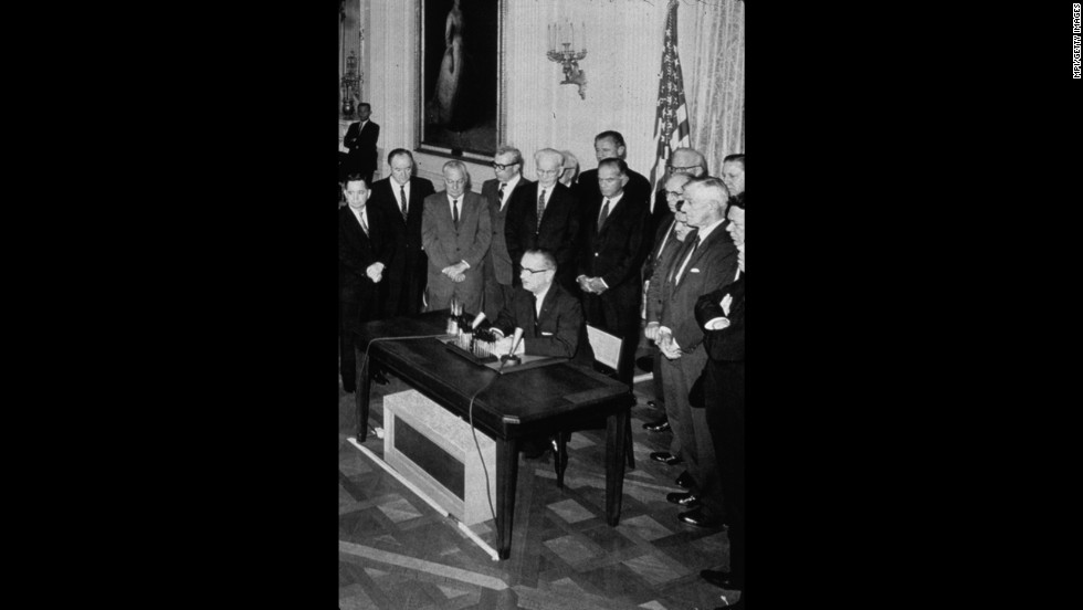 President Lyndon B. Johnson signs the Gulf of Tonkin Resolution in August 1964. The resolution, approved by Congress, gave Johnson power to send U.S. troops to South Vietnam after it was alleged that North Vietnamese patrol boats had fired on the USS Maddox in the Gulf of Tonkin.