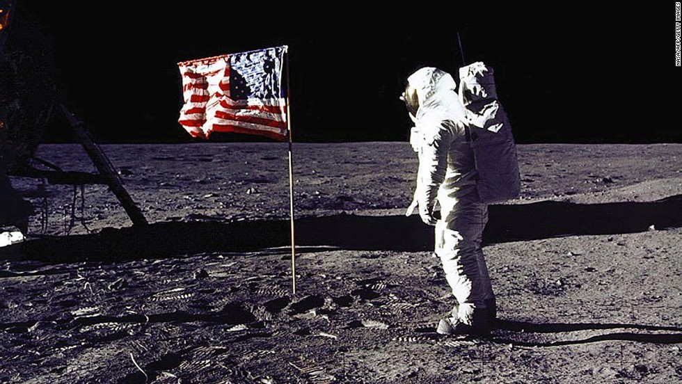 "Apollo 11 astronaut Edwin E. ""Buzz"" Aldrin Jr. salutes the U.S. flag on the lunar surface on July 20, 1969. Aldrin and mission commander Neil Armstrong became the first humans to walk on the moon. Globally, more than half a billion people watched on television."