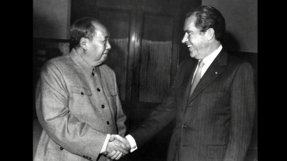 """Chinese leader Mao Zedong shakes hands with U.S. President Richard Nixon after their meeting in Beijing on February 22, 1972. Nixon became the first U.S. president to visit China. The two countries issued a communiqué recognizing their """"essential differences"""" while making it clear that """"normalization of relations"""" was in all nations"""