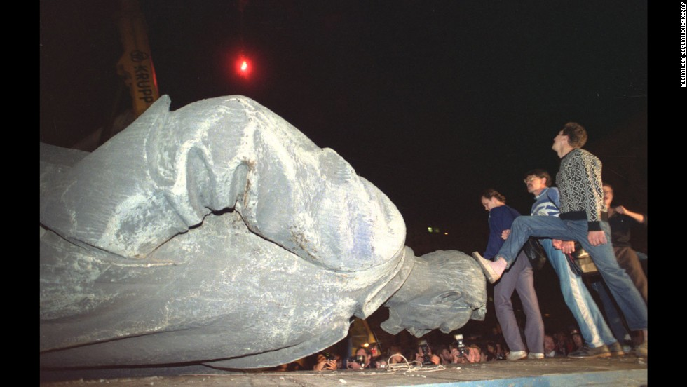 Jubilant people step on the head of the statue of Felix Dzerzhinsky, the founder and chief of the Soviet secret police, later known as KGB, which was toppled in front of the KGB headquarters in Moscow, on August 23, 1991. The KGB was responsible for mass arrests and executions.