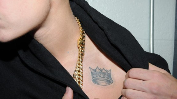 The singer sports a crown tat high on his chest.