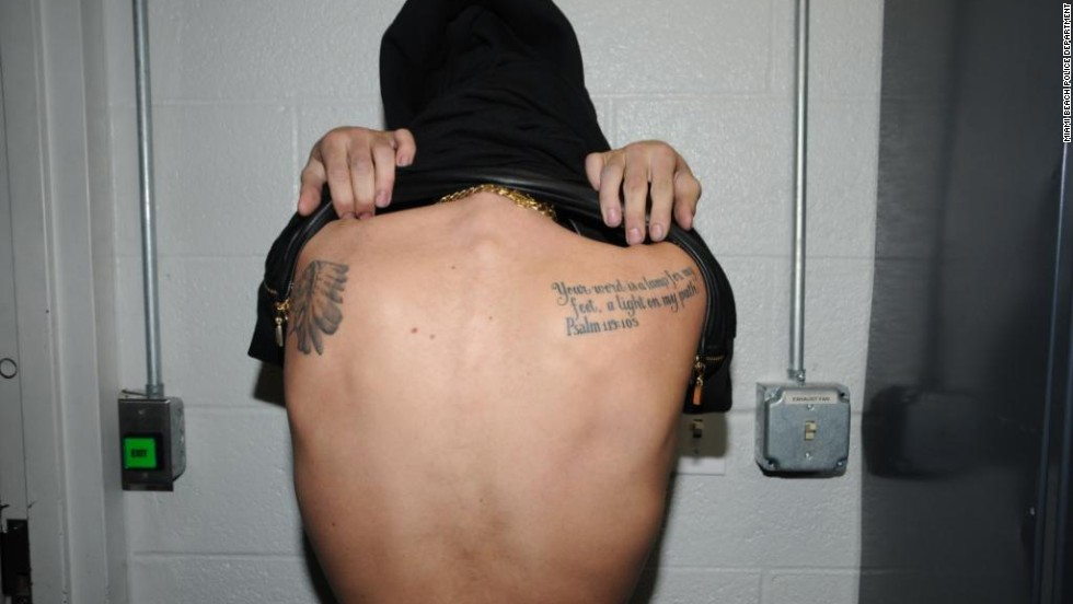 Bieber shows off two tattoos on his shoulder blades.
