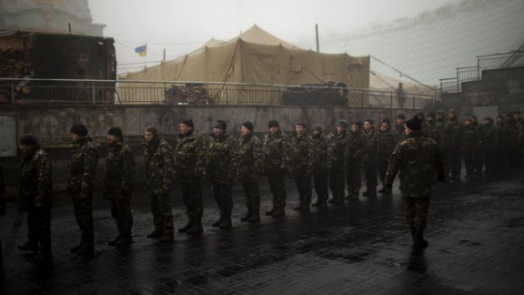 Ukrainian military recruits line up to receive instructions in Kiev