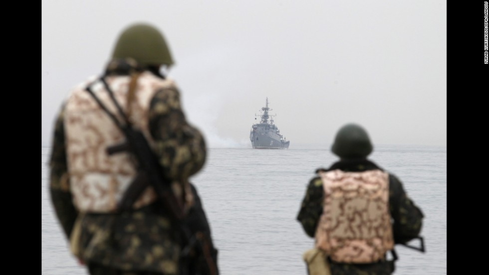 Ukrainian troops watch as a Russian navy ship blocks the entrance of the Ukrainian navy base in Sevastopol on March 4.