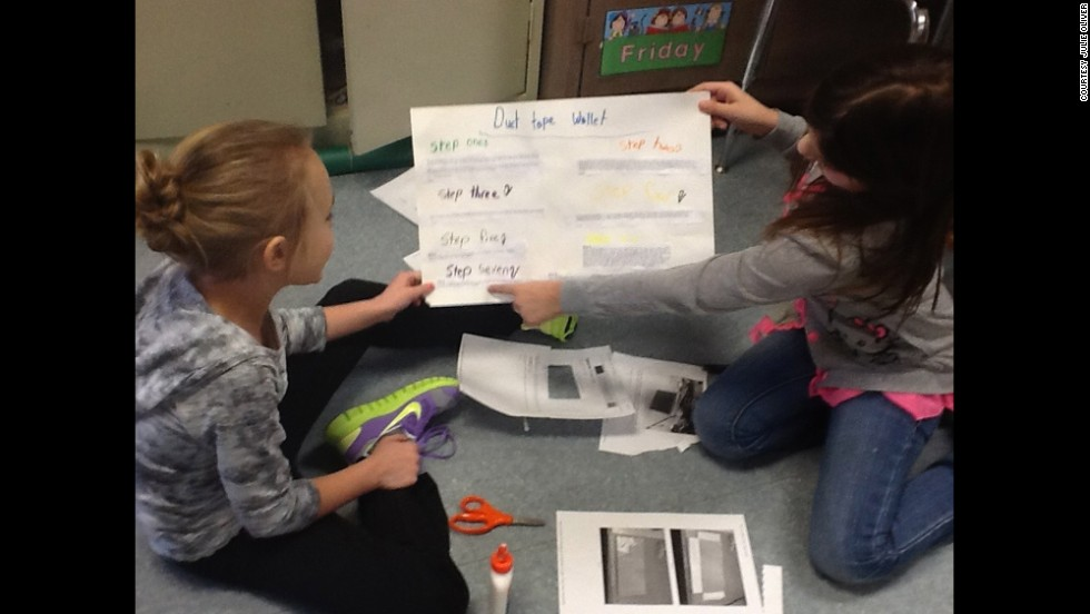 Warner Elementary School third-graders Emma Reed, left, and Jamison Barnes chose to create wallets out of duct tape for their genius hour project. Upon completion, students shared their projects in a classroom presentation.