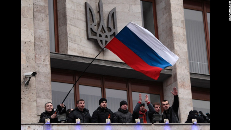 Pro-Russia demonstrators wave a Russian flag after storming a regional administrative building in Donetsk on March 5.