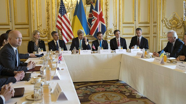 "U.S. Secretary of State John Kerry (6th L) hosts the Budapest Memorandum Ministerial meeting with Ukrainian Foreign Minister Andrii Deshchytsia (R) and British Foreign Secretary William Hague (3rd L) at the U.S. ambassador's residence in Paris, on March 5, 2014. Ukraine's interim government and France today played down the prospect of a full-blown conflict with Russia ahead of potentially crucial talks on the Crimea crisis in Paris. ""We want to keep good dialogue, good relations with the Russian people, "" Ukraine's interim Foreign Minister Andriy Deshchytsya said after meeting his French counterpart Laurent Fabius. AFP PHOTO / POOL / KEVIN LAMARQUEKEVIN LAMARQUE/AFP/Getty Images"