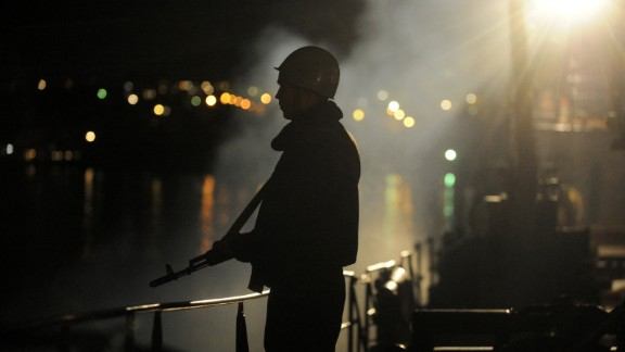A sailor guards the Ukrainian Navy ship Slavutych in the Bay of Sevastopol on Wednesday, March 5.