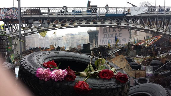 KIEV, UKRAINE:  Portraits of people killed during clashes with riot police are left with candles and flowers at Kiev's Independence Square on March 6.  Photo by CNN's Michael Holmes.  Follow Michael on Instagram at instagram.com/holmescnn.