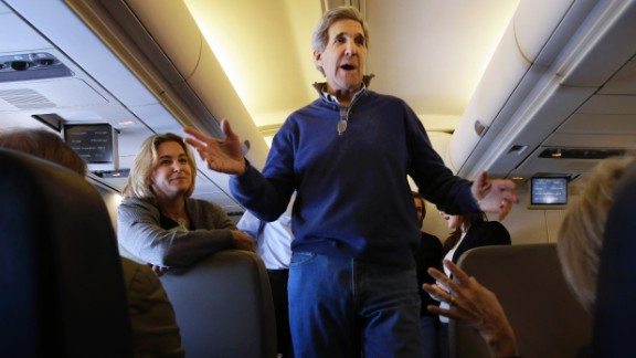 Kerry talks to reporters en route to London on his first trip as secretary of state in February 2013. The trip took him through European and Middle Eastern capitals.