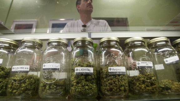 LOS ANGELES, CA - OCTOBER 19:  Dave Warden, a bud tender at Private Organic Therapy (P.O.T.), a non-profit co-operative medical marijuana dispensary, displays various types of marijuana available to patients on October 19, 2009 in Los Angeles, California. Attorney General Eric Holder announced new guidelines today for federal prosecutors in states where the use of marijuana for medicinal purposes is allowed under state law. Federal prosecutors will no longer trump the state with raids on the southern California dispensaries as they had been doing, but Los Angeles County District Attorney Steve Cooley recently began a crackdown campaign that will include raids against the facilities. Cooley maintains that virtually all marijuana dispensaries are in violation of the law because they profit from their product. The city of LA has been slow to come to agreement on how to regulate its 800 to 1,000 dispensaries. Californians voted to allow sick people with referrals from doctors to consume cannabis with the passage of state ballot Proposition 215 in 1996 and a total of 14 states now allow the medicinal use of marijuana. (Photo by David McNew/Getty Images) *** Local Caption *** Dave Warden