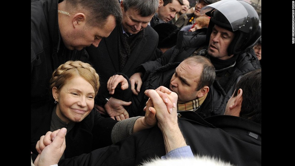 Ukrainian opposition leader Yulia Tymoshenko, left, shakes hands with a woman as she arrives to visit the tent camp of her supporters in Kiev, Ukraine, on Friday, February 28. Tymoshenko, considered a hero of a 2004 revolution against former Ukrainian President Viktor Yanukovych, was released last month after 2½ years behind bars.