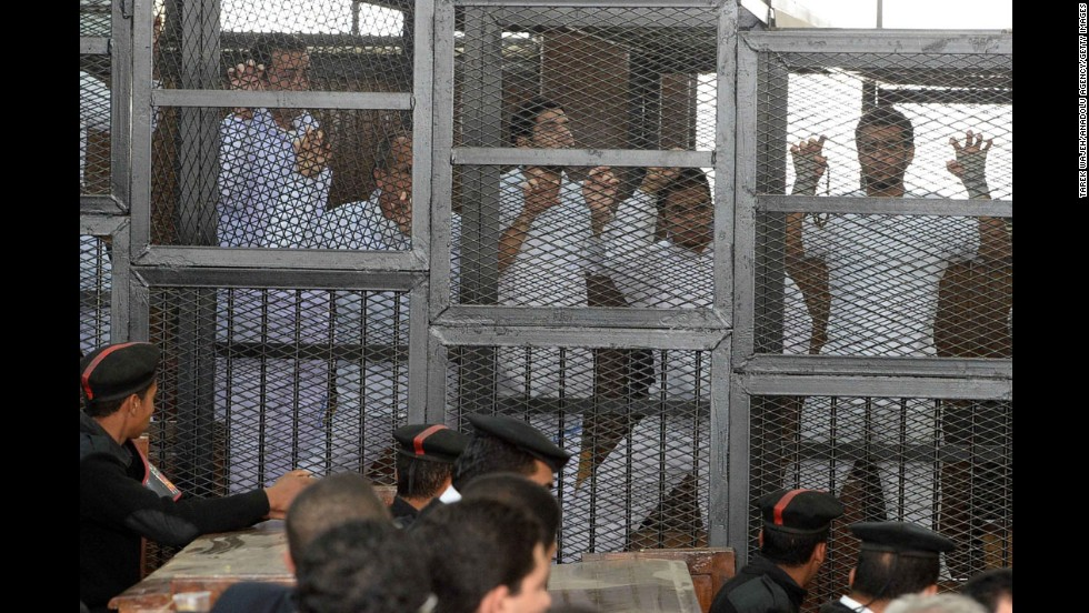"Journalists are seen in cages<a href=""http://www.cnn.com/2014/03/06/world/africa/egypt-al-jazeera-trial/index.html""> during their hearing</a> in Cairo on Wednesday, March 5. Three Al Jazeera English journalists are among 20 accused of spreading ""false news"" and having links to the Muslim Brotherhood, which Egypt declared a terrorist organization in December. The journalists have said they were simply doing their jobs."