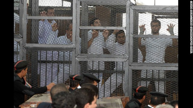 "Al Jazeera journalists are seen in cages during their trail at the Police Institution in Cairo, Egypt on March 5. The journalists are accused of spreading false news and belonging to ""terrorist group"", and broadcasting against Egypt."