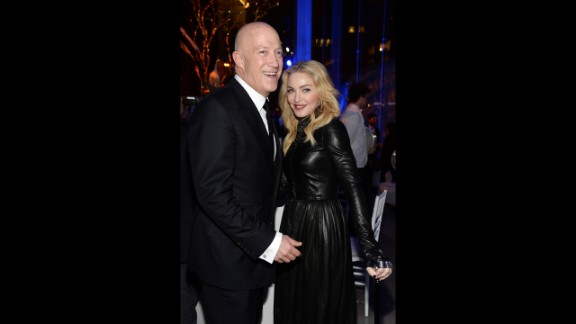 """Madonna, seen here with talent agent Bryan Lourd in February, no longer feels the need to shock with things such as her """"Sex"""" book and <a href=""""http://www.youtube.com/watch?v=MAy-NtCQCB8"""" target=""""_blank"""" target=""""_blank"""">girl-on-girl lip-locking. </a>She recently started the <a href=""""http://www.cnn.com/2013/10/04/showbiz/celebrity-news-gossip/madonna-anderson-cooper-5-things/"""">""""Art for Freedom"""" movement</a>."""