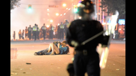 """A couple kisses during a riot in Vancouver, British Columbia, after the hometown NHL hockey team lost the Stanley Cup Final in June 2011. Getty Images, an online photo archive with more than 35 million images, is now allowing """"noncommercial"""" users to use this and other photos for free on their websites or social media. Click through to see some of the other iconic images now available."""