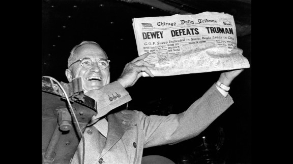 U.S. President Harry Truman holds up a copy of the Chicago Daily Tribune, which mistakenly declared Truman's defeat to Thomas Dewey in the 1948 presidential election.