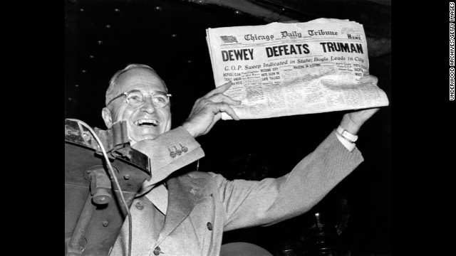 "Harry Truman holds up the Chicago Daily Tribune  with a headline of his ""defeat"" to Thomas Dewey in 1948."