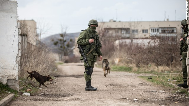 A member of the Russian military patrols around Perevalne, Ukraine, on Thursday, March 6.