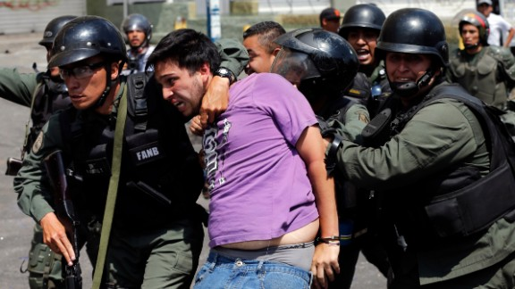 National Guard members arrest an anti-government protester during clashes in the Los Ruices neighborhood of Caracas on Thursday, March 6.