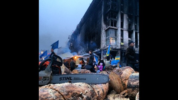 """KIEV, UKRAINE:  """"Cutting wood to keep volunteers warm as they continue to guard Independence Square in Kiev."""" - CNN's Khalil Abdallah on March 5.  Follow Khalil on Instagram at instagram.com/madcameraman."""