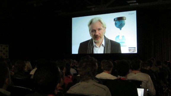 Exiled WikiLeaks founder Julian Assange speaks to a festival audience in Austin, Texas, via livestream from London.