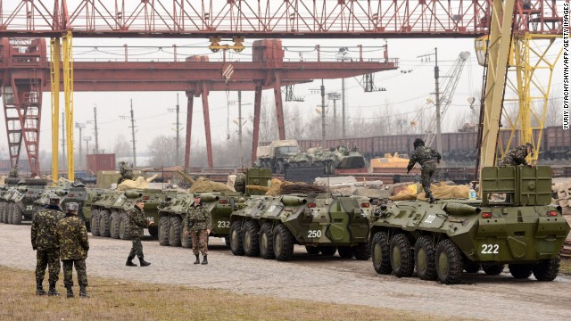 Ukrainian soldiers load armed personnel carriers into boxcars in the western Ukrainian city of Lviv on March 8.