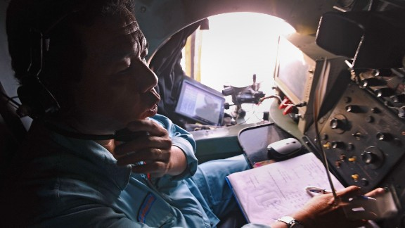 This picture taken from aboard a flying Soviet-made AN-26 used as a search aircraft by Vietnamese Air Force to look for missing Malaysia Airlines flight MH370, shows a crew member taking part in the search operations over the southern seas off Vietnam on March 9, 2014. Malaysia on March 9 launched a terror probe into the disappearance of a Malaysian Airlines passenger jet carrying 239 people the day before, investigating suspect passengers who boarded with stolen passports, as relatives begged for news of their loved ones. The United States sent the FBI to investigate after Malaysia Airlines flight MH370 vanished from radar early on March 8 somewhere at sea between Malaysia and Vietnam, but stressed there was no evidence of terrorism yet.    AFP PHOTO / HOANG DINH NAMHOANG DINH NAM/AFP/Getty Images
