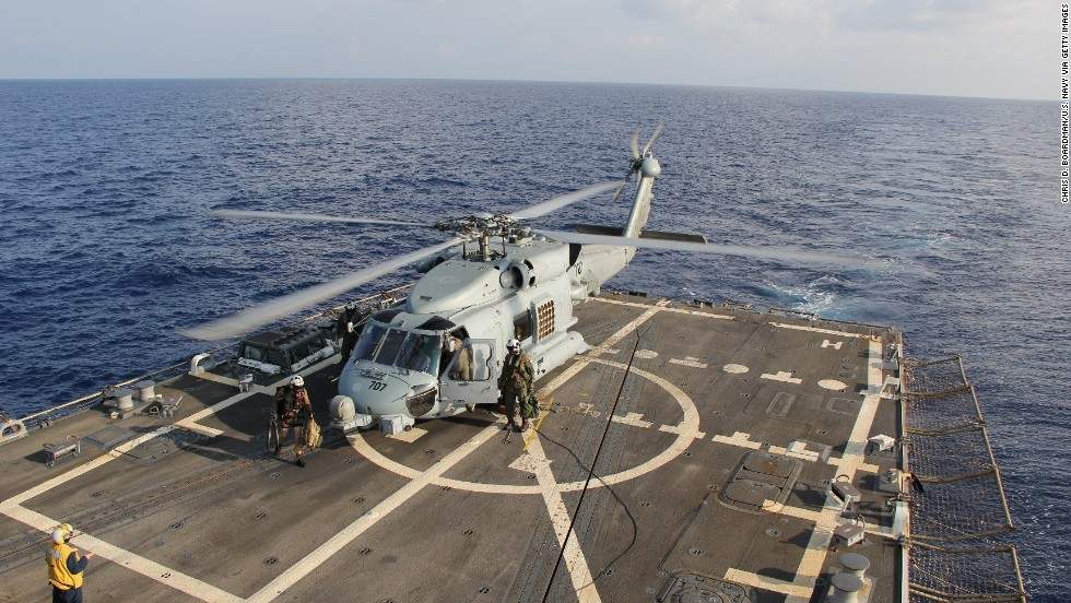 A U.S. Navy Seahawk helicopter lands aboard the USS Pinckney to change crews on March 9, 2014, before returning to search for the missing plane in the Gulf of Thailand.