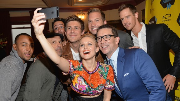 "Actress Kristen Bell poses for a selfie with fellow ""Veronica Mars"" cast members at the premiere of the  ""Veronica Mars"" movie on Saturday, March 8."