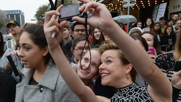 "Actress Tina Majorino (""Napoleon Dynamite"") snaps a selfie with a fan on March 8 as she arrives for the premiere of ""Veronica Mars."""