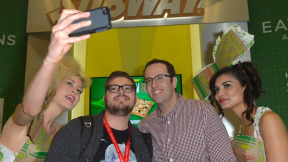 "Jared ""The Subway Guy"" and Subway models pose for a selfie on March 8 with a fan."