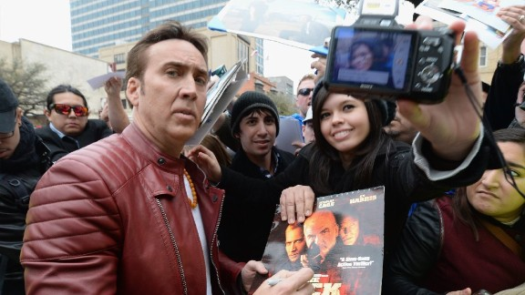 """Selfie"" may have been the word of the year in 2013, but the trend is far from over.  Fans and celebrities alike take part as they attend South by Southwest festival taking place in Austin, Texas. Here, Nicolas Cage poses with a fan on Sunday, March 9."