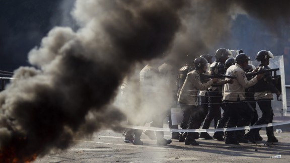 Police keep formation during protests against the government in Caracas on Saturday, March 8.