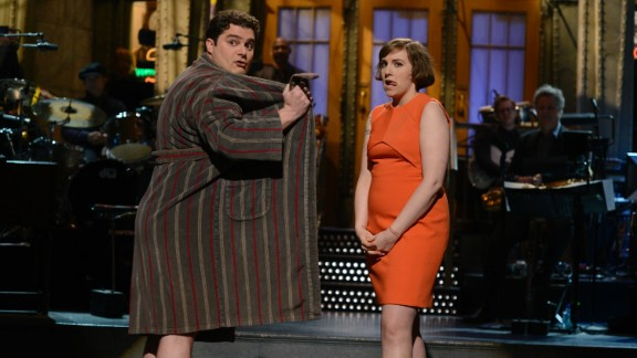 """She's also been on other TV shows. In 2014, she hosted """"Saturday Night Live."""" Here, she shares a moment with Bobby Moynihan."""