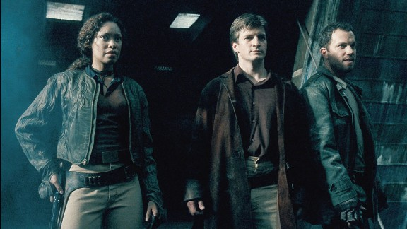 """Joss Whedon's """"Firefly"""" went off the air years ago, but it remains a cult favorite -- in part because of a multiracial cast that also featured women in kick-butt roles. Here, Gina Torres, Nathan Fillion and Adam Baldwin get ready to do battle."""