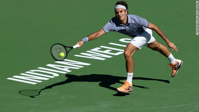 Roger Federer at full stretch during his third round match with Dmitry Tursunov in Monday.