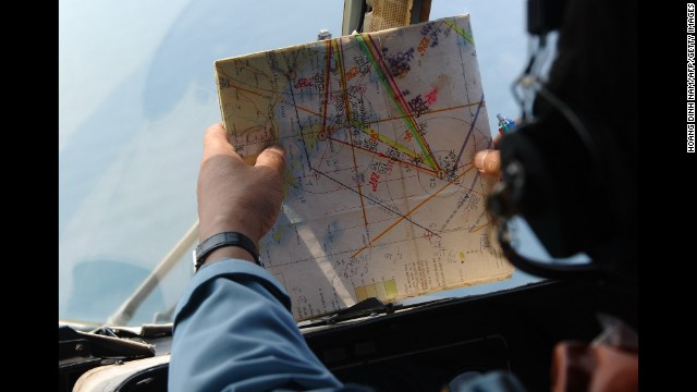 A member of the Vietnamese Air Force checks a map during search operations near Phu Quoc Island off the coast of Vietnam on Tuesday, March 11.