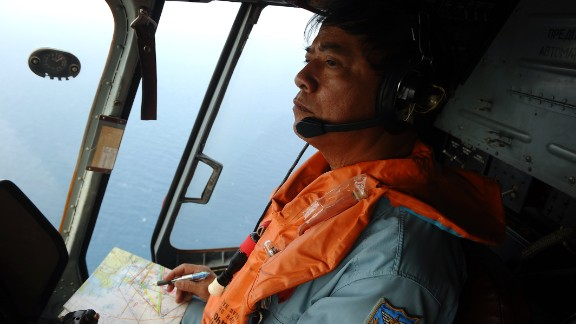 This picture taken aboard a Vietnamese Air Force Russian-made MI-171 helicopter shows a crew member in the cockpit during a search flight some 200 km over the southern Vietnamese waters off Vietnam