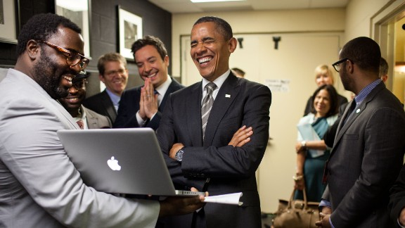 """President Barack Obama lets out a laugh as he is briefed by host Jimmy Fallon and his producers on the """"Slow Jam the News"""" segment before his appearance on """"Late Night with Jimmy Fallon"""" in April  2012."""