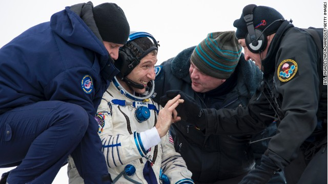 NASA's Mike Hopkins grins as he's helped from the Soyuz capsule near Zhezkazgan, Kazakhstan, on Tuesday.