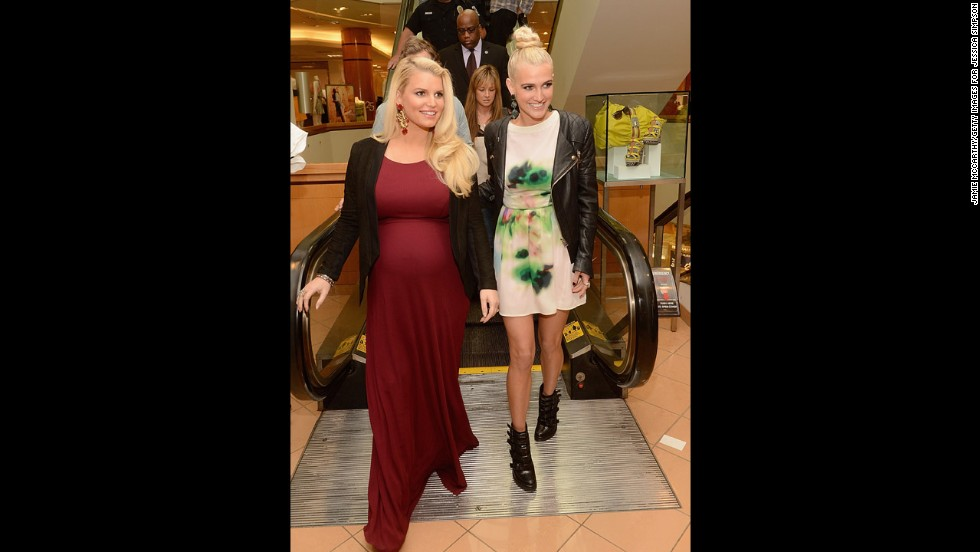 "Simpson gained less weight during her second pregnancy but wasn't obsessive about her diet. ""I will never understand why people give pregnant women such a hard time,"" <a href=""http://www.usmagazine.com/celebrity-moms/news/jessica-simpson-on-kim-kardashian-pregnancy-bullying-i-knew-exactly-what-she-was-going-through-201359#ixzz2vkiWULxp "" target=""_blank"">she told US Weekly</a>. ""We are creating a human life: I think we get every excuse in the world to eat a doughnut!"" Here she is with her sister, Ashlee."